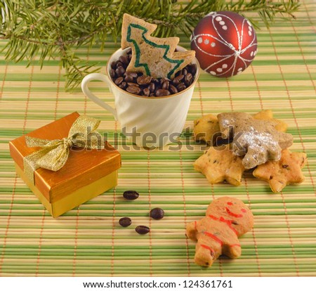 Christmas card with coffee beans, cookies and gift box with golden bow