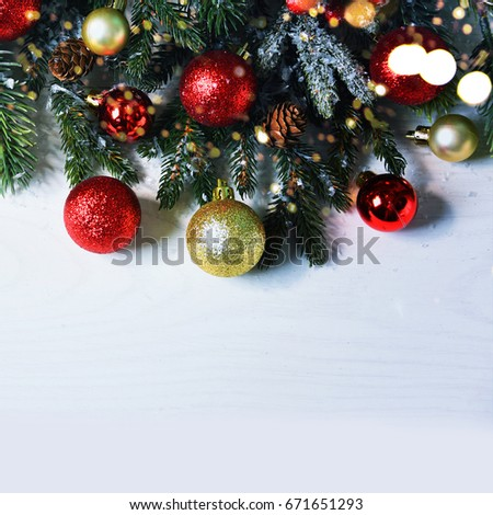 Christmas card with fir and decor on glitter background - Shutterstock ID 671651293