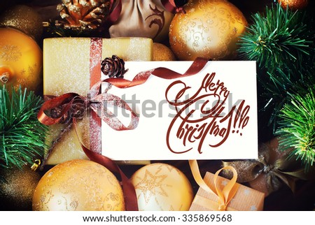 Christmas Card with Golden Balls Toy Fir Tree and Message Merry Christmas on the Letter isolated on white. #335869568