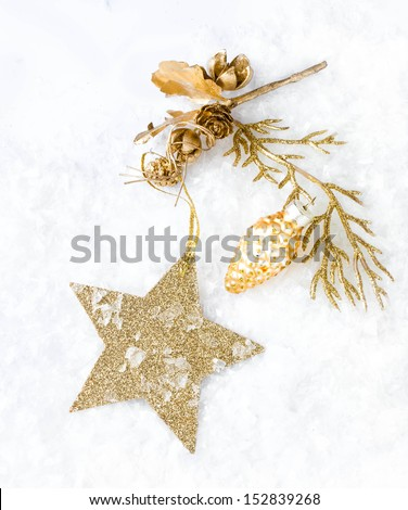 Christmas card with golden star and decorations on snow   lights background