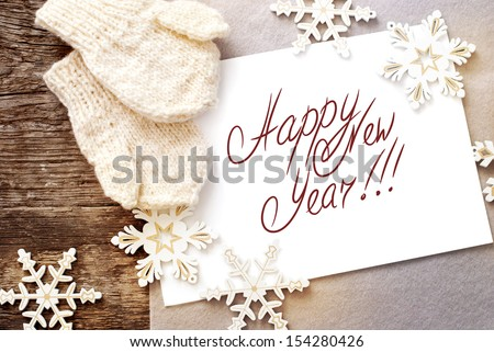 Christmas Card with Message Happy New Year on the letter isolated on white, decorated snowflakes and mittens