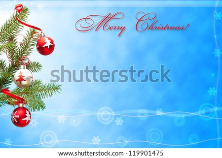 Christmas card with photo of decorated branch of fir tree on blue background.