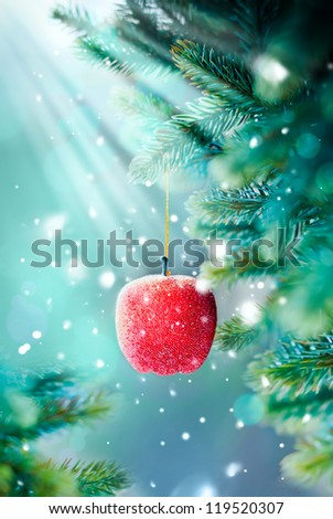 Christmas Card with Red Apple on the Branch