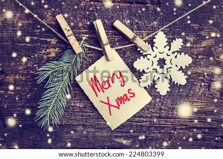 christmas card with snowflakes,fir  on wooden background/ Christmas card with christmas natural decorations #224803399