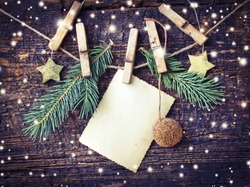 christmas card with stars,fir and fir-cone on wooden background/ Christmas card with christmas natural decorations