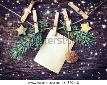 christmas card with stars,fir and fir-cone on wooden background/ Christmas card with christmas natural decorations #164890118