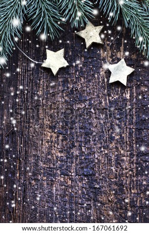 christmas card with stars,fir on wooden background #167061692