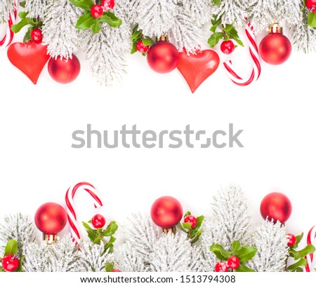 Christmas card. Xmas background with green Xmas tree branch, winter berries and red glass balls