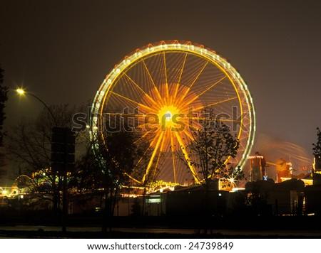 Christmas carousel in city night fair
