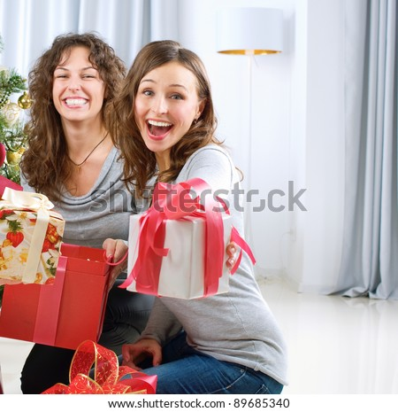 Christmas celebration. Friends with Christmas Gifts . New Year party