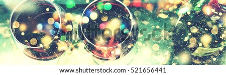 Stock Photo Christmas. Celebration. Magical fairy background. Bokeh, blur, blurre. Wine in a glass. selective focus, motion blur, Red wine in a glass on a blue background old. Thanksgiving Day.