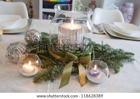 christmas centerpiece with candles and christmas balls