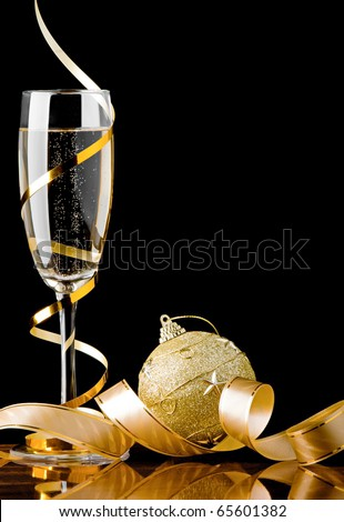Christmas champagne with ribbon and toy ball