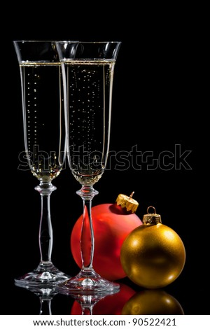 Christmas champagne with ribbon and toy ball - stock photo