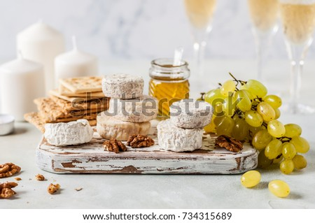 Christmas Cheese Platter, Variety of French Cheeses, Green Grapes, Walnuts, Honey and Crackers