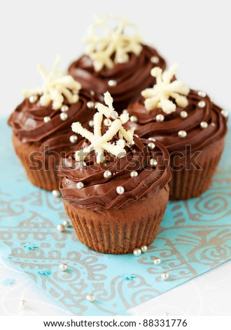 Christmas chocolate cupcake decorated with snowflakes