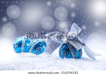 Christmas.Christmas blue balls and silver ribbon snow and space abstract background. #316296242