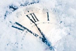 Christmas clock on snow. New year concept