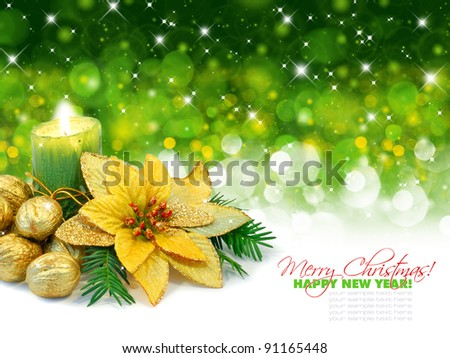 Christmas composition. Candle with gold nuts on a festive green background