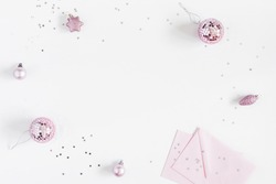 Christmas composition. Christmas balls, envelopes, pink and silver decorations on white background. Flat lay, top view, copy space