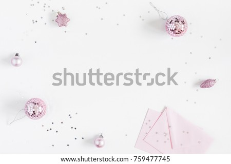 Christmas composition. Christmas balls, envelopes, pink and silver decorations on white background. Flat lay, top view, copy space #759477745