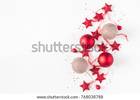 Christmas composition. Christmas balls, garland, red and golden decorations on white background. Flat lay, top view, copy space #768038788