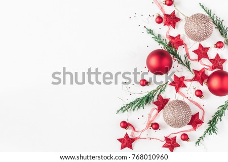 Christmas composition. Christmas balls, garland, red and golden decorations , pine tree branches on white background. Flat lay, top view, copy space #768010960