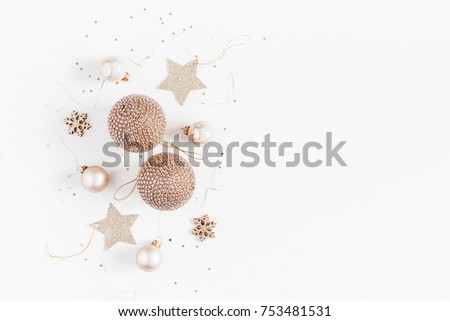 Christmas composition. Christmas balls, golden decorations on white background. Flat lay, top view, copy space