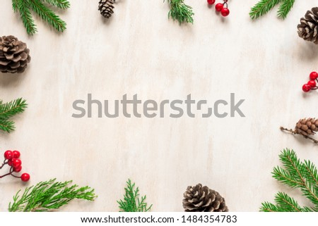 Christmas composition. Christmas decor, pine cones, fir branches on white wooden background. Flat lay, top view, copy space.