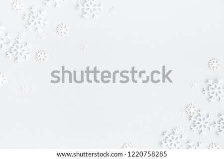 Christmas composition. Christmas frame made of snowflakes on pastel gray background. Winter concept. Flat lay, top view, copy space - Shutterstock ID 1220758285