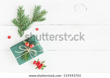 Christmas composition. Christmas gift, fir branches. Flat lay, top view