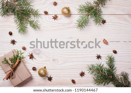 Christmas composition. Christmas gift, knitted blanket, pine cones, fir branches on wooden white background. Flat lay, top view, copy space #1190144467