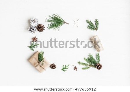 Christmas composition. Christmas gift, pine cones, fir tree branches. Top view, flat lay. #497635912