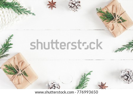 Christmas composition. Christmas gifts, fir tree branches, knitted blanket on white wooden background. Flat lay, top view, copy space - Shutterstock ID 776993650
