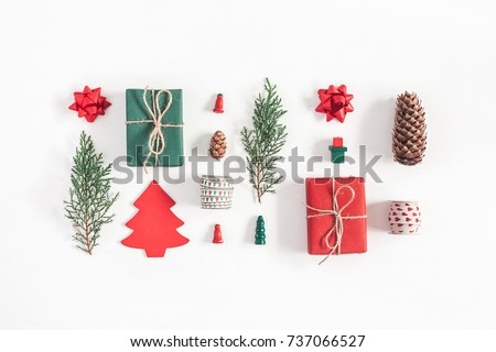 Christmas composition. Christmas gifts, pine branches, toys on white background. Flat lay, top view.