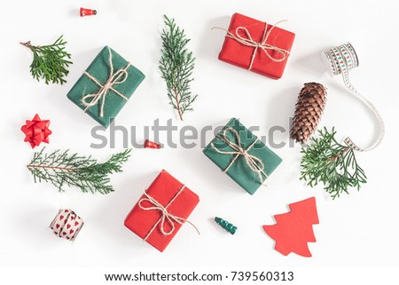 Shutterstock Christmas composition. Christmas gifts, pine branches, toys on white background. Flat lay, top view