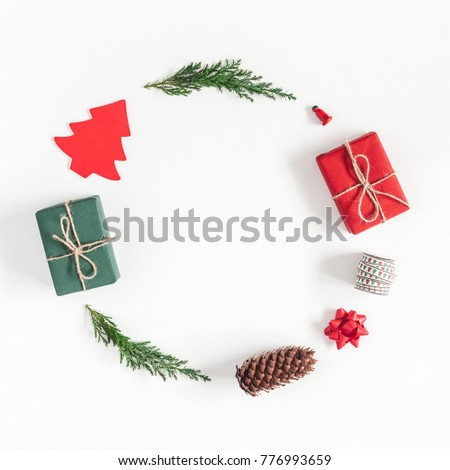 Christmas composition. Christmas gifts, pine branches, toys on white background. Flat lay, top view #776993659