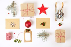 Christmas composition. Christmas gifts with envelopes and decoration on white background. Top view, flat lay, copy space