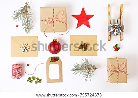 Shutterstock Christmas composition. Christmas gifts with envelopes and decoration on white background. Top view, flat lay, copy space