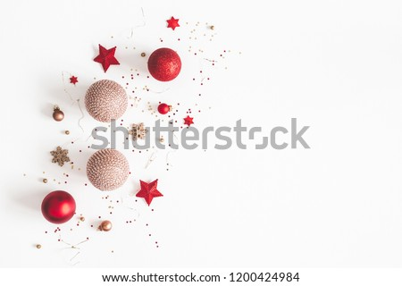 Christmas composition. Christmas red and golden decorations on white background. Flat lay, top view, copy space
