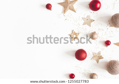 Christmas composition. Christmas red and golden decorations on white background. Flat lay, top view, copy space #1255027783