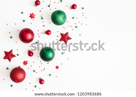 Christmas composition. Christmas red and green decorations on white background. Flat lay, top view, copy space #1203983686