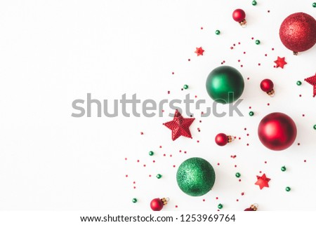 Christmas composition. Christmas red and green decorations on white background. Flat lay, top view, copy space #1253969764