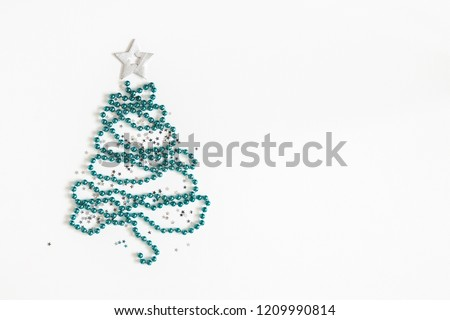 b7520335a940 Christmas composition. Christmas tree made of blue and silver decorations  on white background. Flat