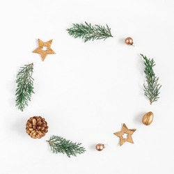 Christmas composition. Christmas wreath made of fir branches, balls, pine cones on white background. Flat lay, top view, copy space, square