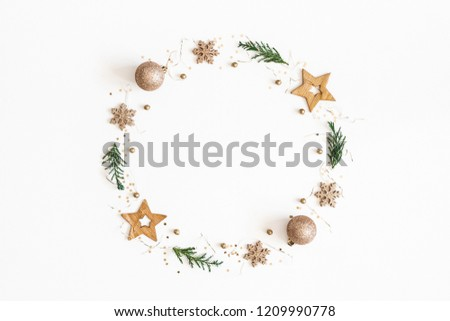 Christmas composition. Christmas wreath made of golden decorations, fir tree branches on white background. Flat lay, top view, copy space #1209990778