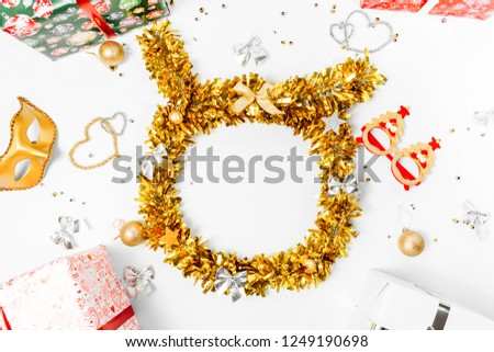 Christmas composition. Christmas wreath of golden tinsel and Christmas decor on a white background. copy space