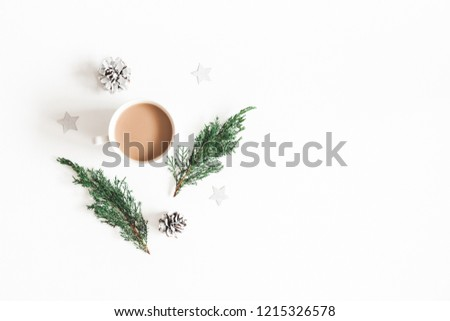 Christmas composition. Cup of coffee, fir tree branches, pine cones on white background. Flat lay, top view, copy space