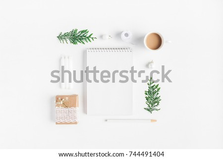 Shutterstock Christmas composition. Cup of coffee, notebook, thuja branches on white background. Christmas, winter, new year concept. Flat lay, top view, copy space