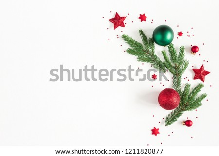 Christmas composition. Fir tree branches, red and green decorations on white background. Christmas, winter, new year concept. Flat lay, top view, copy space #1211820877